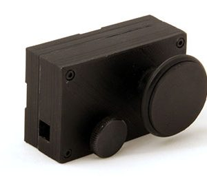 The large knob controls the movement of the rack through the winder, while the smaller knob locks the rack in place when the desired position is reached.